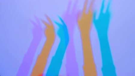 polychrome : Interactive exposition in science museum. Colored shadows of woman hands. Science, optical and physics concept