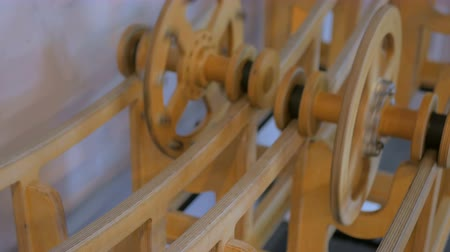 rotational : Interactive exposition in science museum - competition of two same size wooden wheels with different weight. Science, physics and experiment concept Stock Footage
