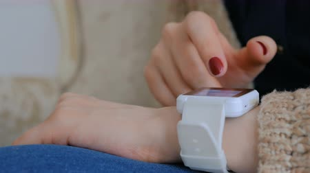 pols : Woman using smart watch at home. Entertainment and technology concept Stockvideo