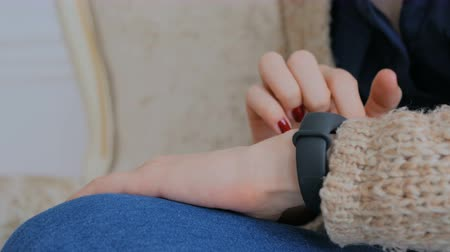 pedometer : Young woman using wearable fitness tracker. Technology concept. Close up shot of woman hand with wristwatch