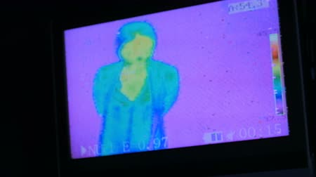 detection : Thermographic camera view of woman. Blue, green, yellow colors show different temperatures