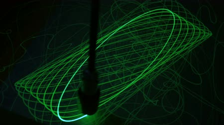 argon : Big pendulum draws ellipses with light on phosphorus surface. Science, physics and experiment concept
