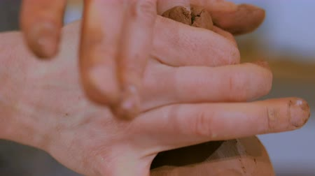 louça de barro : 4 shots. Professional male potter making ceramic jug in pottery workshop, studio. Close up shot of potters hands. Handmade, art and handicraft concept Stock Footage