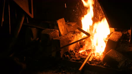 rabble : Burning fire in furnace at forge, workshop. Blacksmith equipment concept Stock Footage