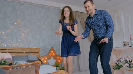 squirm : Happy young parents and their baby daughter playing togerher at home. Family, childhood and leisure concept