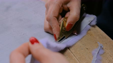 mink : Professional woman skinner, furrier working with mink fur skin at atelier, workshop. Fashion and leatherwork concept Stock Footage