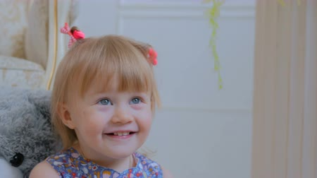 тянуть : Portrait of funny little girl at home. Family, childhood and leisure concept. Close up shot of baby girl face