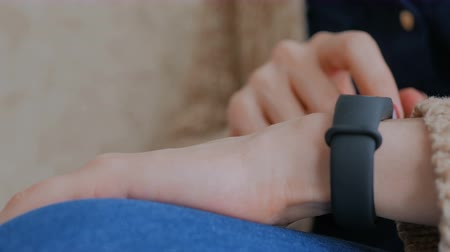 Young woman using wearable fitness tracker. Technology concept. Close up shot of woman hand with wristwatch