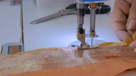 Professional tailor, fashion designer sewing clothes with sewing machine at atelier, studio. Fashion and tailoring concept Wideo