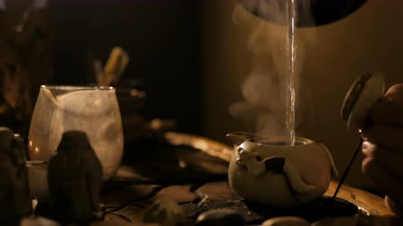 Traditional chinese tea ceremony. Warm romantic illumination, low key. Relaxation, meditative and chinese culture concept