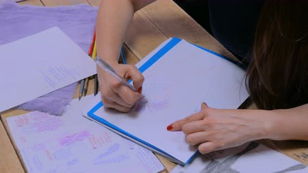 Professional tailor, designer drawing fashion sketch at atelier, studio. Dressmaking, creativity and tailoring concept