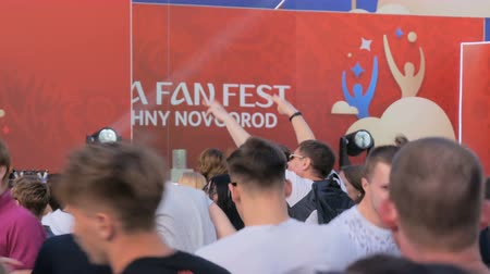 hayranlık : NIZHNIY NOVGOROD, RUSSIA - JUNE 2018: FIFA World Cup 2018 - FIFA Fan Fest - People partying at Pendulum open air concert in front of the stage