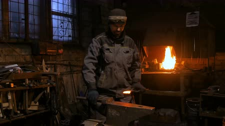 alicate : 4 shots. Professional blacksmith working with metal on anvil at forge, workshop. Handmade, craftsmanship and blacksmithing concept