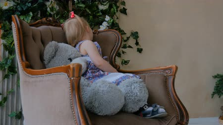 squirm : Portrait of funny little girl with bear doll at home. Family, childhood and leisure concept Stock Footage