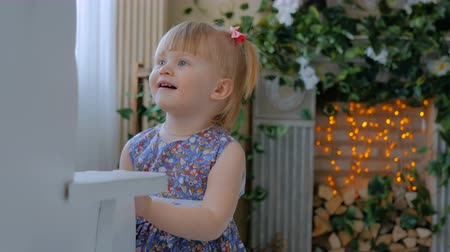 squirm : Little girl playing with white wooden rocking horse. Family, childhood, game and leisure concept Stock Footage