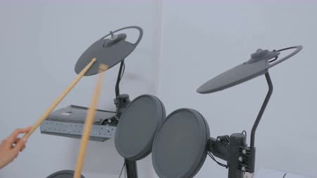 tentar : Woman learning to play on electronic drum set. Art, education and entertaiment concept Stock Footage