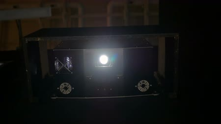 prezentaci : Front view of digital film projector, lens flares