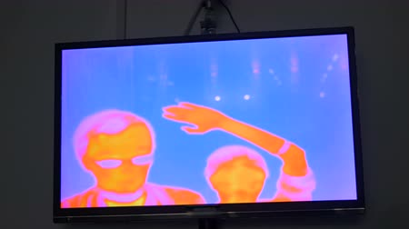 infra : Thermographic camera view of woman and man