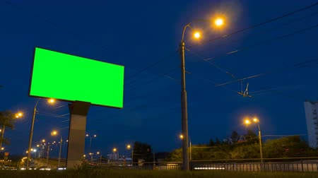 billboards : Green screen billboard on highway with traffic at evening time. Timelapse shot with fast moving cars Stock Footage