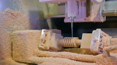 drilling wood : CNC engraving milling machine cutting wooden workpiece at futuristic technology exhibition. Woodworking, carving, industrial and manufacturing concept Stock Footage