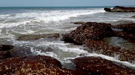 goa : Timelapse of stony coast of the Arabian Sea, Strong waves break against big rocks. Summer travel concept.